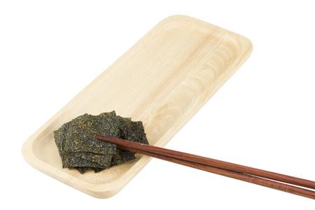 Sheet of crispy seaweed on wooden bowl isolated on white background