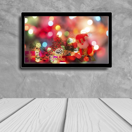 christmas decoration with hdtv on concrete wall background Stock Photo
