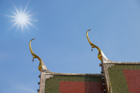 temple roof in thailand with blue sky