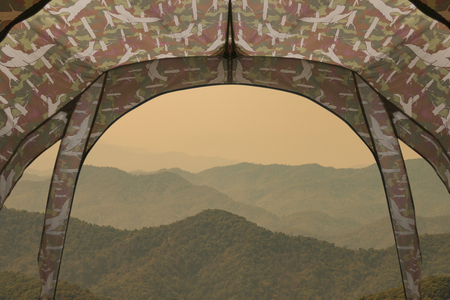 Tent lookout on a camp with the mountain hill.