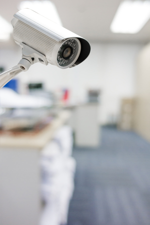 CCTV Camera security operating in office building.