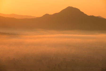 Beautiful sunrise :silhouette of the mountain with foggy at morning.