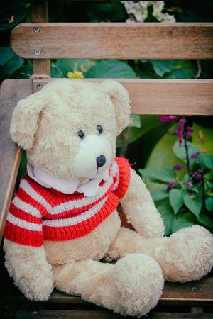 teddy bear sitting on the chair - vintage style