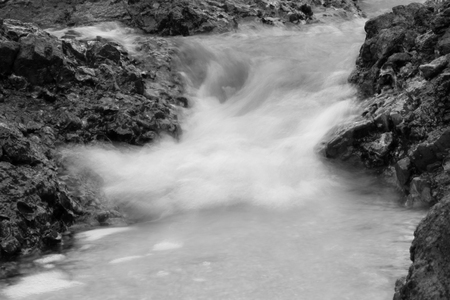 stones by the sea. waves of the sea from long exposure - black and white tone.