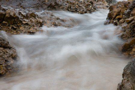 stones by the sea. waves of the sea from long exposure Stockfoto