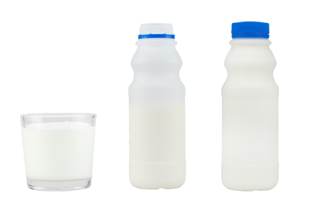 bottle of milk and milk in glass isolated on white background - clipping paths