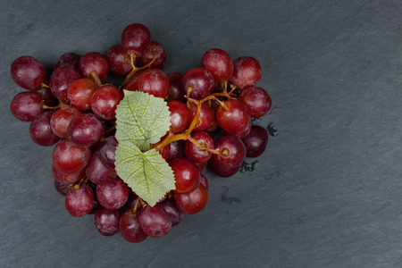 Ripe red grape on the dark background