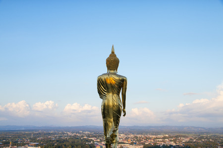Golden Buddha statue standing at Wat Phra That Khao Noi, Nan Province, Thailand Stockfoto - 119504342