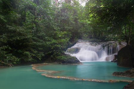 Beautiful waterfall - Erawan waterfall at Erawan National Park in Kanchanaburi, Thailand. Stockfoto - 119504345