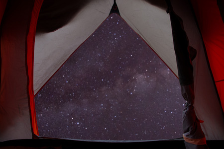 night view from inside of tent. spectacular starry sky and milky way background. Stockfoto