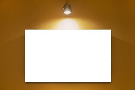 white blank board on wall with lamp.