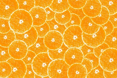 Background of fresh orange slices as background. Stockfoto