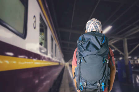 Young man traveler with backpack in the railway, Travel concept. Stockfoto