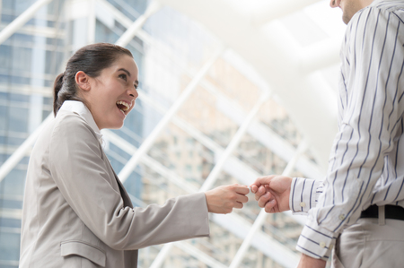 Businesswoman gives business card to colleague