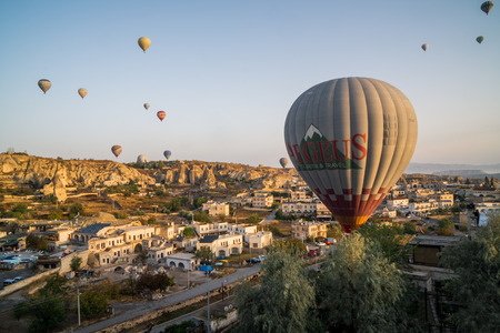 Cappadocia, Turkey-Oct-2018 : View from hotel in Cappadocia in morning with amazing hot air balloons in ancient city