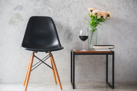 Chair, flower and wineglass in house for decoration