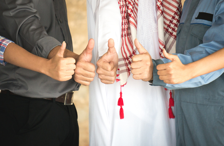 Colleague showing thumb with successful in business 스톡 콘텐츠