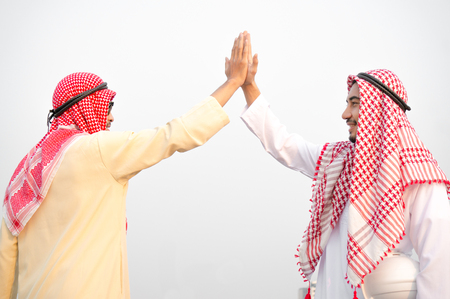 Arab businessman meet and greet with colleague 스톡 콘텐츠