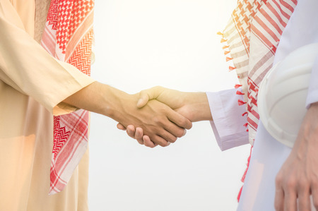 Arab businessman meet and greet with colleague and shake hands