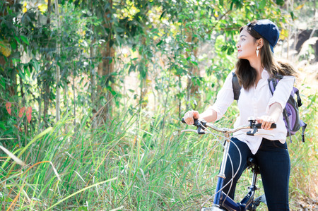Asian woman feeling relax in green forest