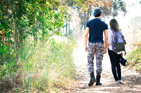 Asian couple with hand in hand in national park on forest background 스톡 콘텐츠