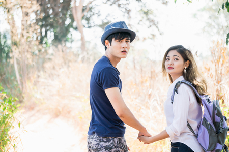Asian couple feeliing relax together in forest