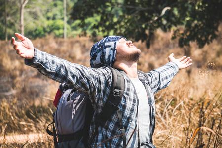 Asian traveler feeling relax in forest