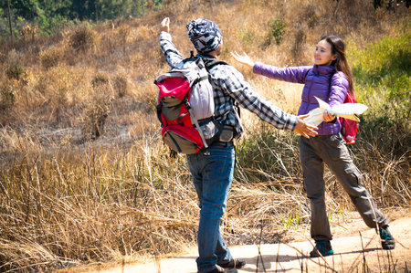 Asian travelers say hello and greeting in forest 스톡 콘텐츠