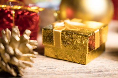 Gold present with decoration background with space for Christmas celebration for happy new year 2018 스톡 콘텐츠 - 121328909