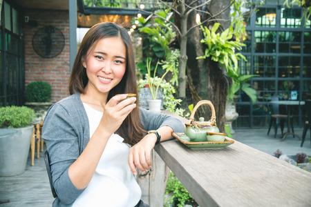 Asian women drink hot tea in coffee shop