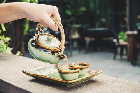 Pour tea by teapot Asian Style
