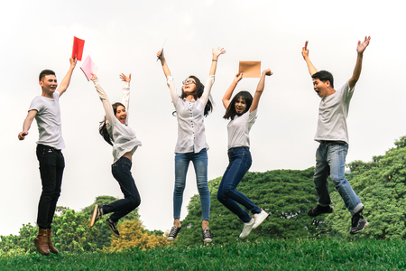 Asian students feeling happy after completed final exam