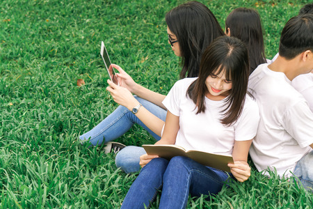 Asian student prepare to final exam with friend in park 스톡 콘텐츠