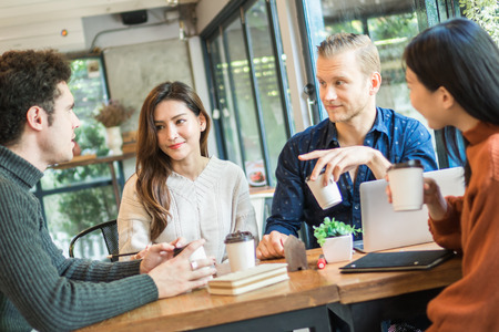Young businessman and woman meeting and share idea to colleague 스톡 콘텐츠