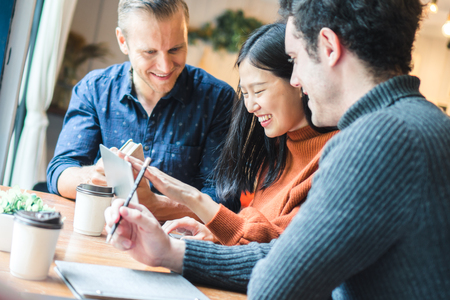 Businessman and partners discuss about business plan in café