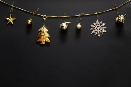 Christmas background with decoration, gold tree, snow flake, bubbles and star with copy space. Flat lay, top view. 스톡 콘텐츠