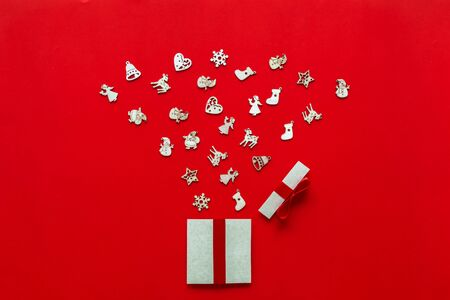 Christmas gifts presents paper art on red background with festive holiday decorations