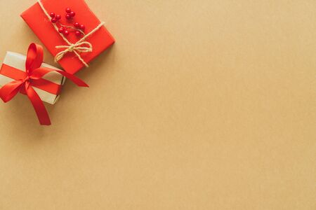 Christmas gifts on paper background with copy space. Flat lay, top view