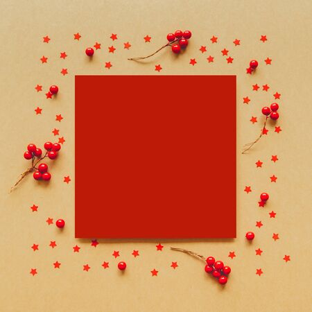 Christmas Flame made from red berries and star on paper background. Flat lay, top view. 스톡 콘텐츠