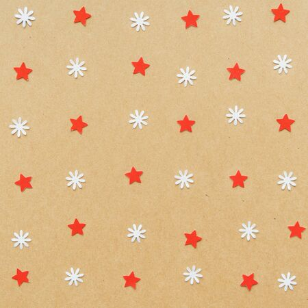Christmas background made from paper star and snow flake. Flat lay, top view.