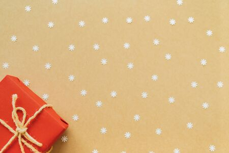 Christmas background with paper snow flake and christmas gifts on paper. Flat lay, top view. 스톡 콘텐츠