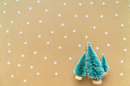 Christmas background with paper snow flake and decoration, tree on paper. Flat lay, top view. 스톡 콘텐츠