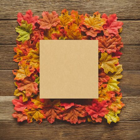 Autumn Thanksgiving day background from maple leaves frame on table wood vintage tone with red, orange, yellow and brown 스톡 콘텐츠