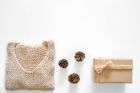 Christmas background with decoration, gift, pine cones, branchs, gold bubble and Knitting sweater and copy space
