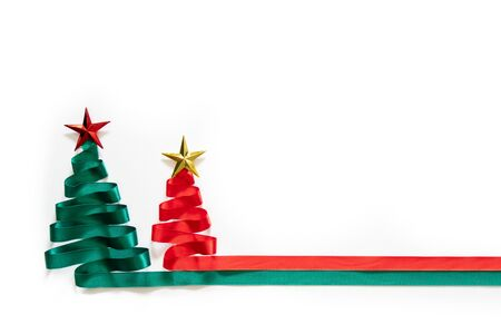 Christmas trees made from green and red ribbon with gold star on white background with coppy space 스톡 콘텐츠