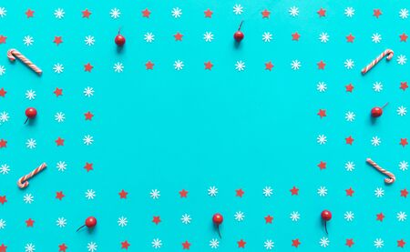 Christmas decorations on blue paper background with copy space. Flat lay, top view