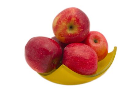 bawl: Red fresh apples in yellow bawl isolated on white background