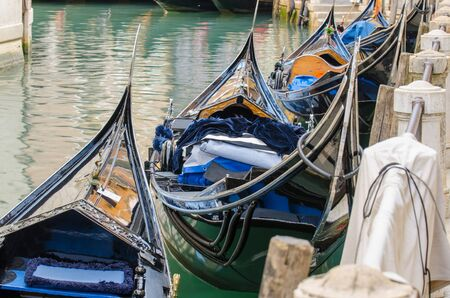 gondolas: Gondolas waiting for you in Venice. Close up of Gondolas along grand canal in Venice, Italy. Stock Photo
