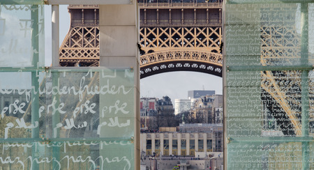 miserly: Perspective of Eiffel Tower seen through the Peace Monument in Paris