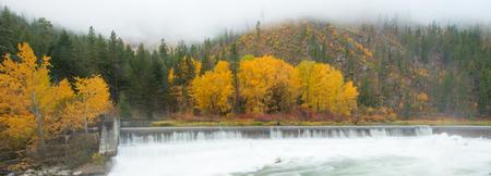 thru: Panorama view of Leavenworth with Tumwater river flow thru the foilage in Autumn, Washington